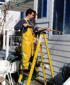 Technician from Interactive Resources conducting AAMA 501.2, Field Check of Metal Storefronts, Curtain Walls, and Sloped Glazing Systems for Water Leakage
